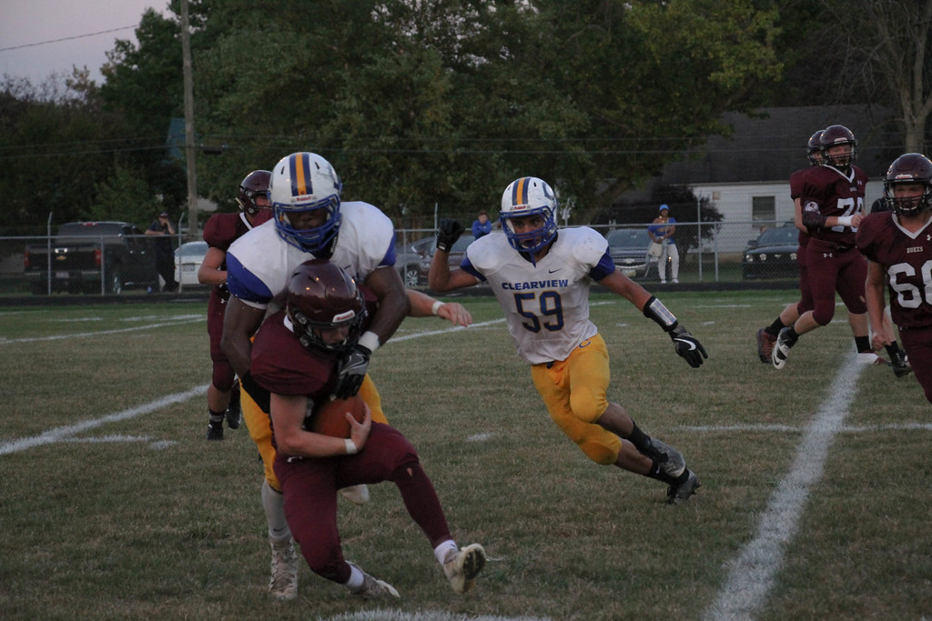 . Nicholas Pfeifer - The Morning Journal<br> Clearview\'s Kahliel Fenderson delivers a hit on Wellington\'s Mason Wright on Sept. 15.