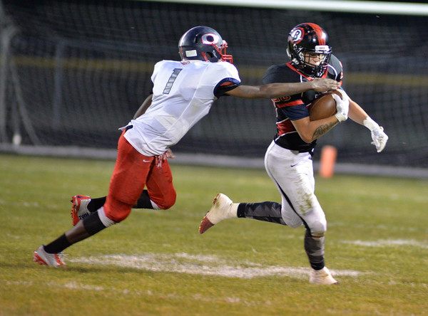 . Aimee Bielozer - The Morning Journal<br> Oberlin\'s Justin Smith looks to make a tackle on Brookside quarterback Jonathan Hice on Sept. 15.