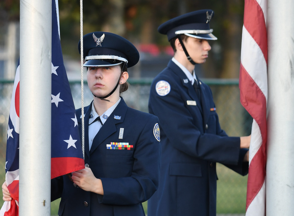 . Eric Bonzar�The Morning Journal<br> Members of the Midview Junior ROTC present the colors, Sept. 15, 2017.