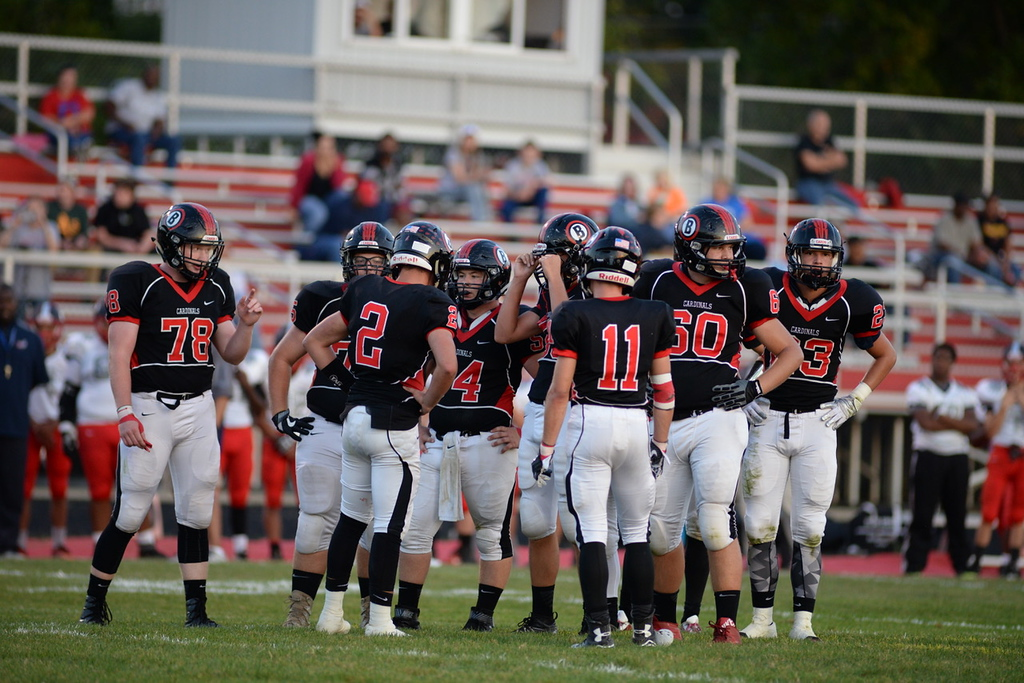 . Aimee Bielozer - The Morning Journal<br> Brookside huddles up before a play against Oberlin on Sept. 15.