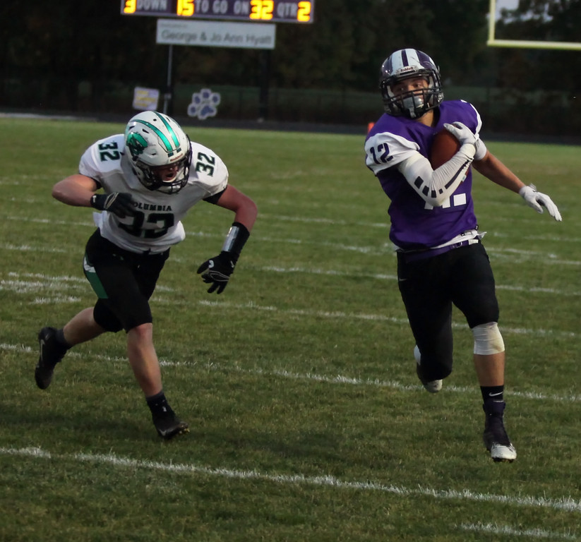 . Randy Meyers - The Morning Journal<br> Jarod Febel makes the catch near the sideline for a big gain as Columbia\'s Cole Schwartz closes in for the tackle on Sept. 15.