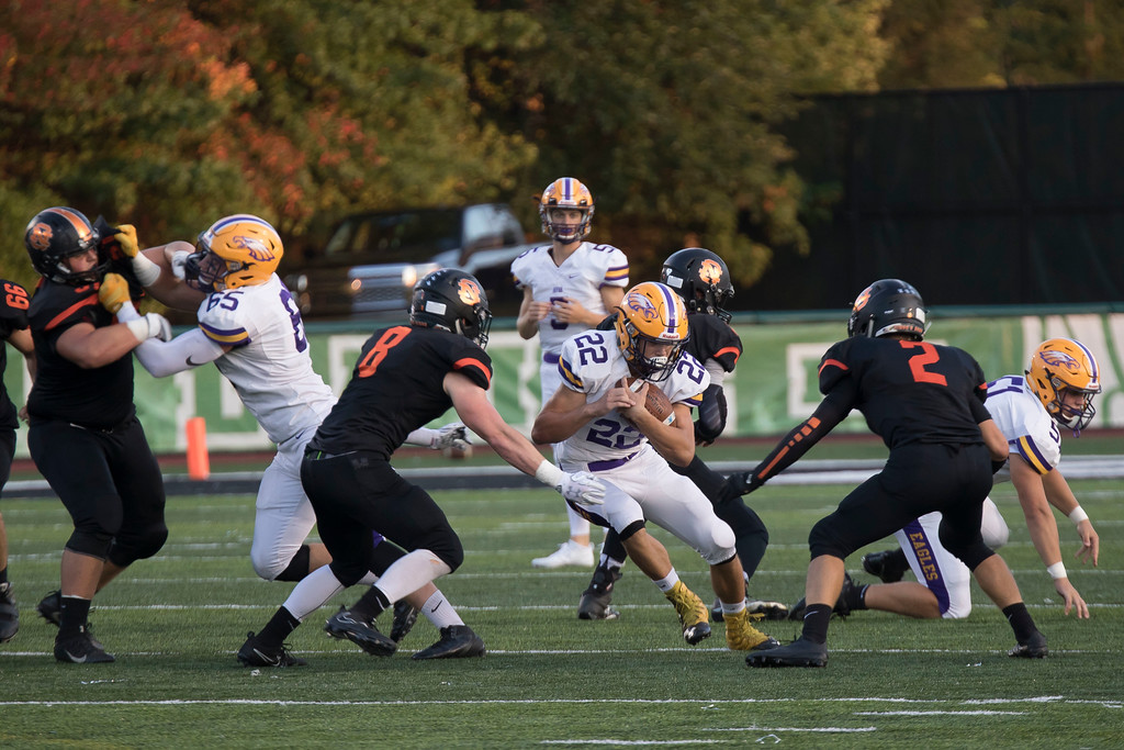 . Jen Forbus - The Morning Journal<br> Avon running back Nick Perusek looks for an opening between North Olmsted\'s Avery Jones and Sean Conroy on Sept. 15.