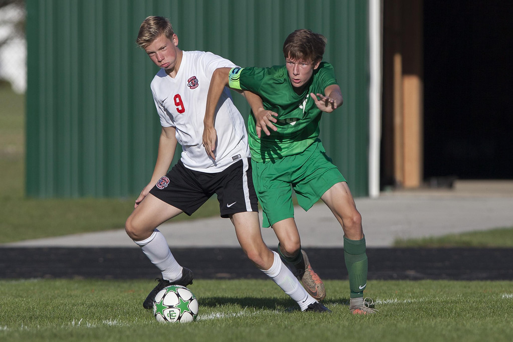 . Jen Forbus - The Morning Journal Panther Alex Steindl and Pioneer Allen Prechtel race for the ball.