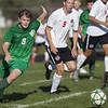 Jen Forbus - The Morning Journal<br /> Panther defender Jonathan Woodyard sends the ball down the pitch.