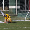 Jen Forbus - The Morning Journal<br /> Elyria Catholic goalkeeper Bryce Hileman isn't able to stop a penalty kick.