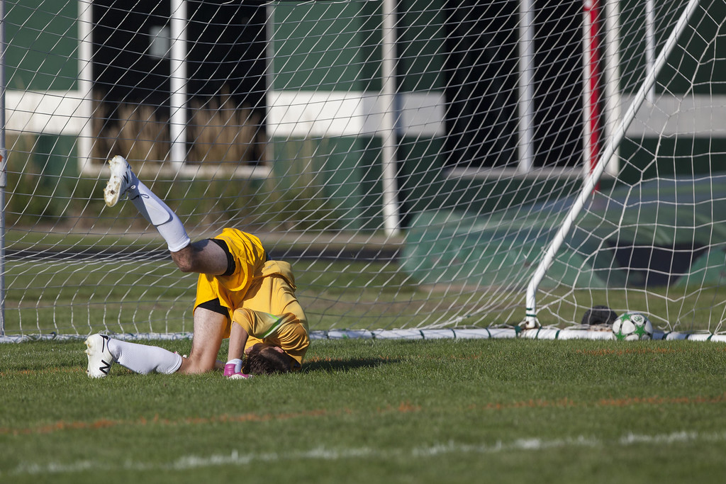 . Jen Forbus - The Morning Journal Elyria Catholic goalkeeper Bryce Hileman isn\'t able to stop a penalty kick.
