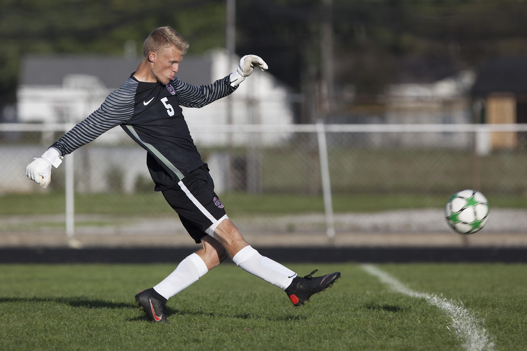 . Jen Forbus - The Morning Journal Elyria goalkeeper Logan Boddy gives the ball a boot in the Pioneer\'s game against the Elyria Catholic Panthers September 15.