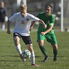 Jen Forbus - The Morning Journal<br /> Pioneer Joshua Rader drives down the pitch with Panther Asa Kempton hot on his heels.