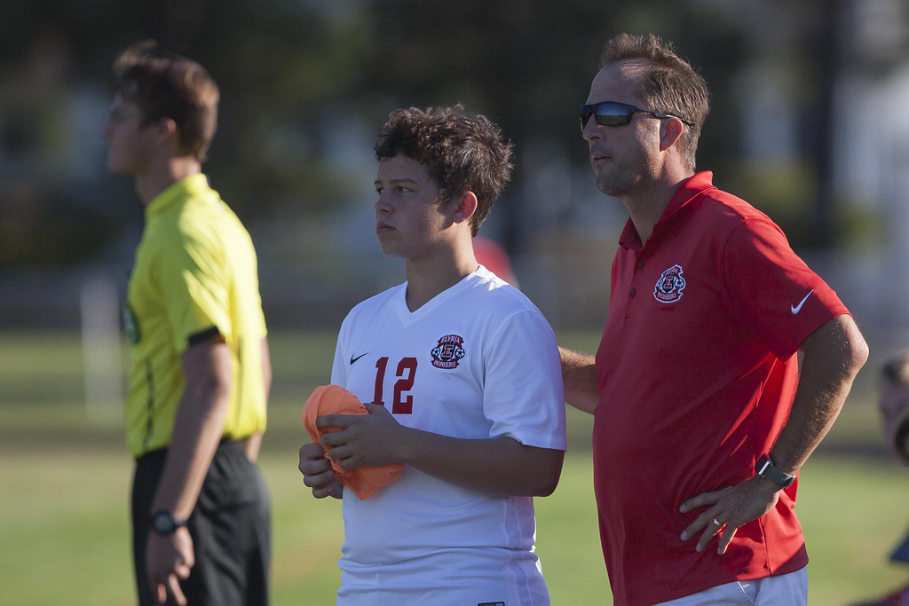 . Jen Forbus - The Morning Journal Elyria coach Brett Heighberger prepares to send Owen Noel into the game.