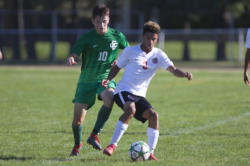 Jen Forbus - The Morning Journal<br /> Pioneer Charles Locklear keeps himself between Elyria Catholic's Michael Bova and the ball.