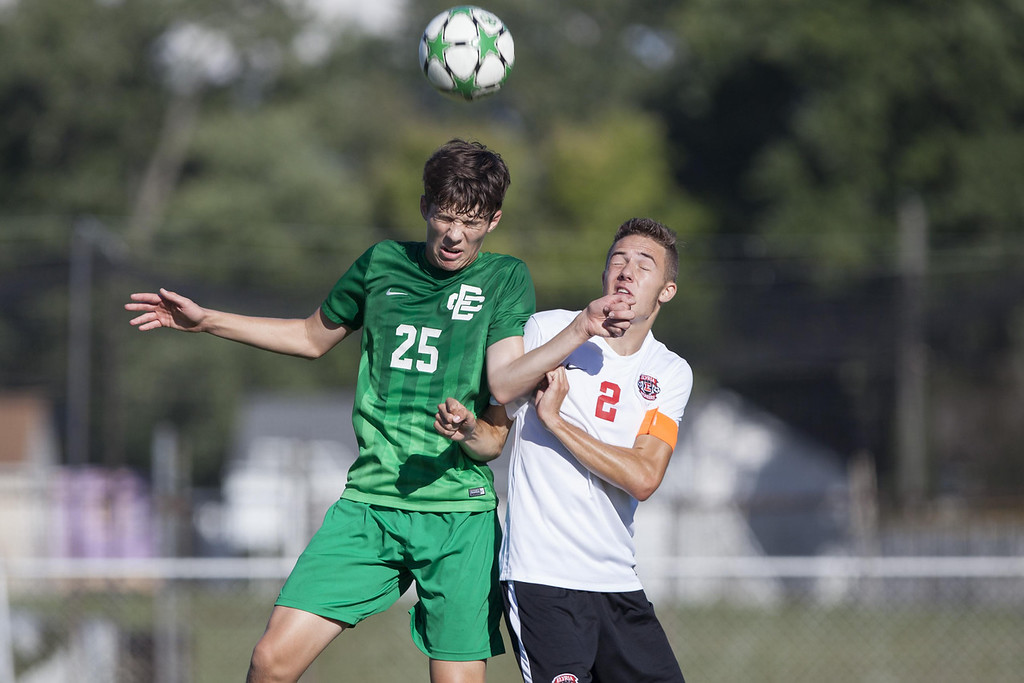 . Jen Forbus - The Morning Journal Elyria Catholic\'s Patrick Delaney and Elyria\'s Alex Heighberger leap to head the ball.
