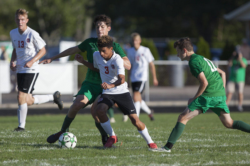Jen Forbus - The Morning Journal<br /> Elyria's Charles Locklear tries to keep himself between EC's Patrick Delaney and the ball.