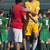 Jen Forbus - The Morning Journal<br /> Elyria High School coach Brett Heighberger wishes Elyria Catholic goalkeeper, Bryce Hileman, good luck before the start of the game September 15.