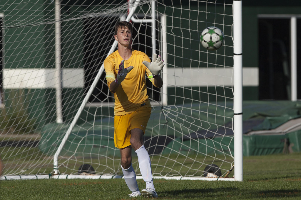 . Jen Forbus - The Morning Journal Panther goalkeeper Bryce Hileman makes a save on goal.