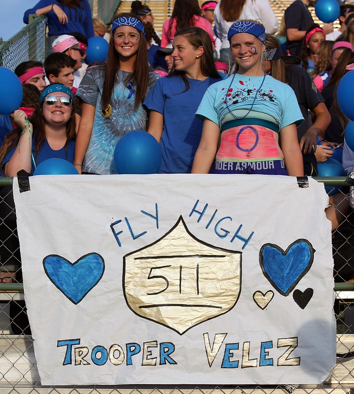 . Randy Meyers - The Morning Journal The Amherst student body shows support for Trooper Velez and his son, Christian, on Friday night against Berea-Midpark.