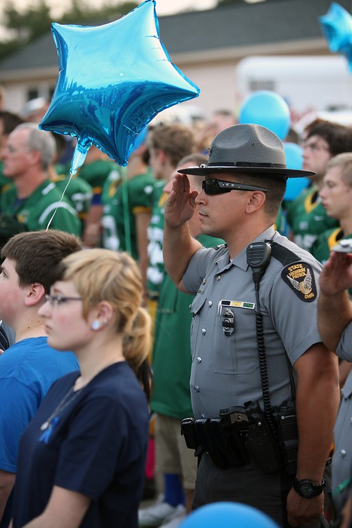 . Randy Meyers - The Morning Journal A member of the Ohio State Highway Patrol salutes the flag during the national anthem prior to Amherst hosting Berea-Midpark on Sept. 16. State troopers attended the game to honor the memory of Trooper Kenny Velez and support his son, Christian, who is a sophomore on Amherst\'s football team.