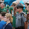 Randy Meyers - The Morning Journal<br /> A member of the Ohio State Highway Patrol salutes the flag during the national anthem prior to Amherst hosting Berea-Midpark on Sept. 16. State troopers attended the game to honor the memory of Trooper Kenny Velez and support his son, Christian, who is a sophomore on Amherst's football team.