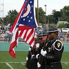 Randy Meyers - The Morning Journal<br /> The State Highway Patrol Honor Guard display the colors in memory of fallen officer kenneth Velez at Friday night's game in Amherst.