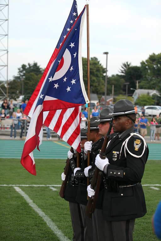 . Randy Meyers - The Morning Journal The State Highway Patrol Honor Guard display the colors in memory of fallen officer kenneth Velez at Friday night\'s game in Amherst.