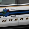 Randy Meyers - The Morning Journal<br /> An Amherst police cruiser is marked with the Honor Guard emblem for Friday's football game.