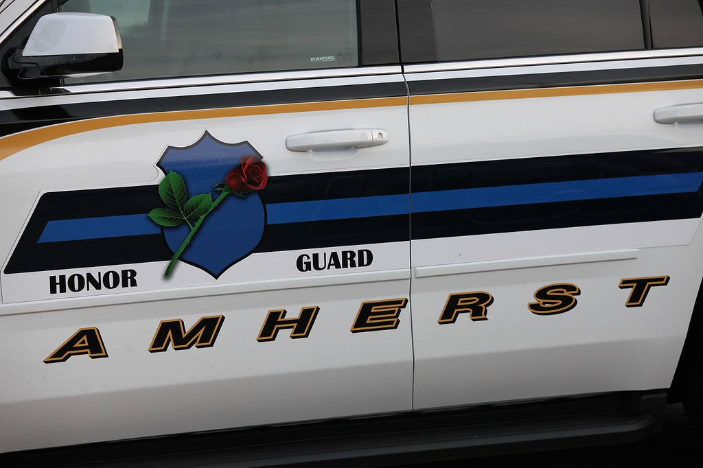 . Randy Meyers - The Morning Journal An Amherst police cruiser is marked with the Honor Guard emblem for Friday\'s football game.