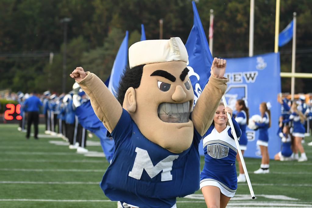 . Eric Bonzar�The Morning Journal The Midview mascot leads the team on to the field Sept. 16, 2016.