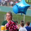 Randy Meyers - The Morning Journal<br /> Amherst cheerleader Maycee Frederick pauses just before the national anthem on Friday night.
