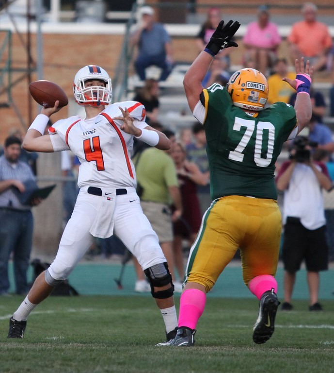 . Randy Meyers - The Morning Journal Amherst\'s Matt Lee puts pressure on Berea-Midpark quarterback Trevor Bycznski during the first quarter on Friday night.