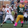 Randy Meyers - The Morning Journal<br /> Amherst's Matt Lee puts pressure on Berea-Midpark quarterback Trevor Bycznski during the first quarter on Friday night.