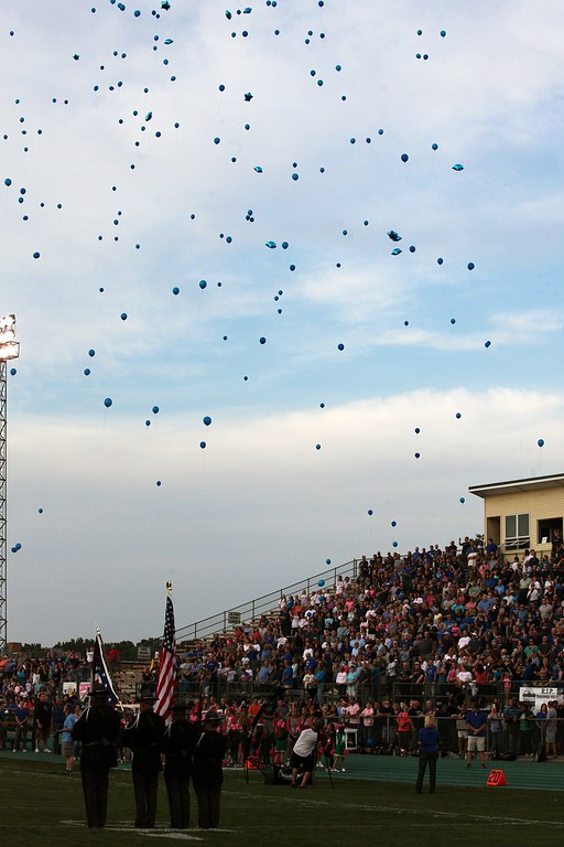 . Randy Meyers - The Morning Journal Blue balloons were launched by the Amherst grandstand in memory of fallen officers during Friday night\'s football game.