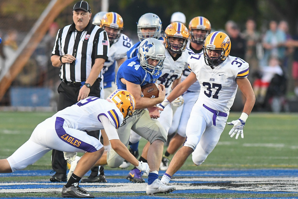 . Eric Bonzar�The Morning Journal The Avon Eagles\' defense swarms on Midview running back Alec Forrer (24) Sept. 16, 2016.