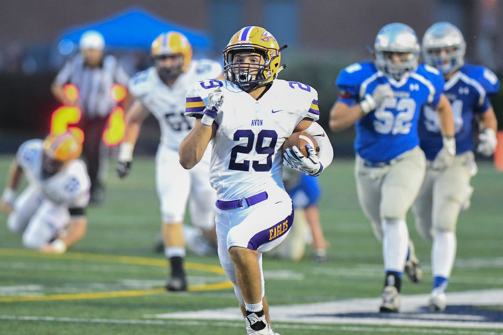 . Eric Bonzar�The Morning Journal Avon running back Mason McLemore (29) shreds off a huge gain, Sept. 16, 2016.