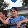 Randy Meyers - The Morning Journal<br /> Grant Dobo, age 12, of Amherst awaits the balloon release in memory of fallen officers.