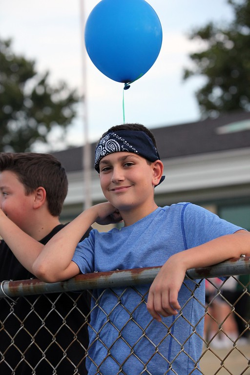 . Randy Meyers - The Morning Journal Grant Dobo, age 12, of Amherst awaits the balloon release in memory of fallen officers.