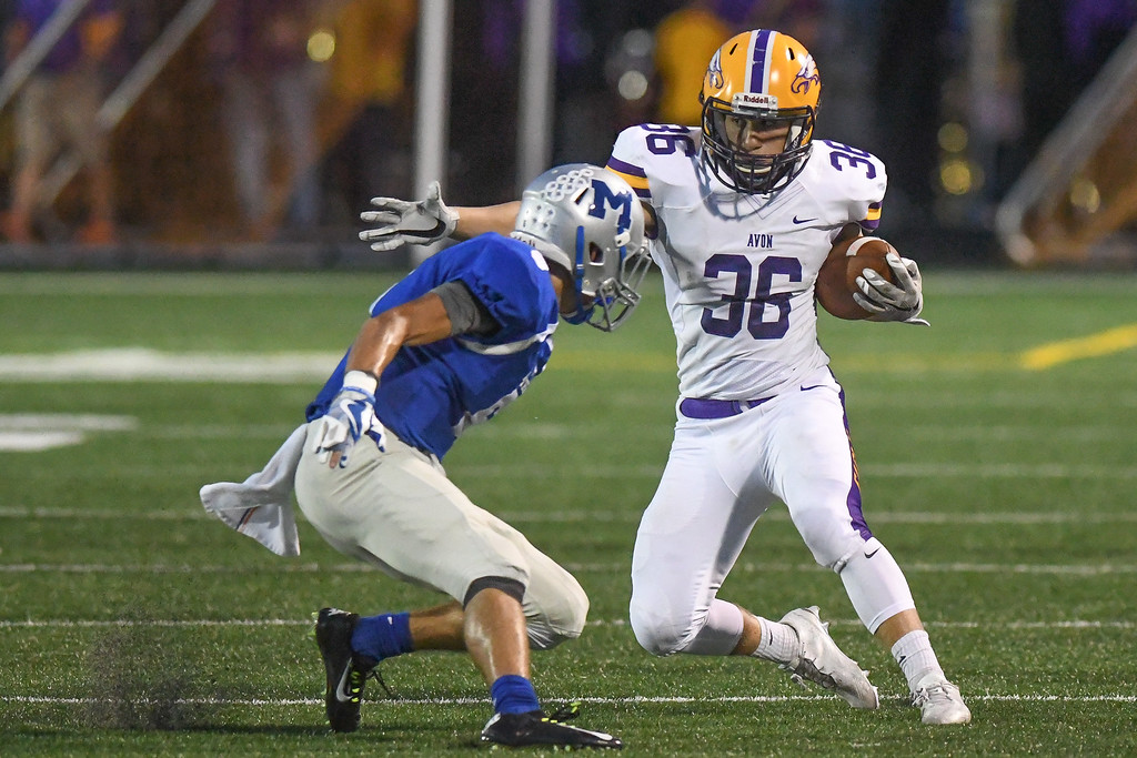 . Eric Bonzar�The Morning Journal Avon running back Aaron Endrizal (36) shakes Midview\'s Jake Scheetz (6), Sept. 16, 2016.