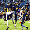Brittany Chay - The News-Herald<br /> Euclid's Isiah Claytor (10), Ramone Collins (8), Kishaun Carroll (7) and teammates celebrate a touchdown during Euclid's 47-37 victory Sept. 15 at Euclid.