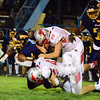 Brittany Chay - The News-Herald<br /> Euclid's De'Quan Pruitt is tackled by Mentor's Ryan Bischof during the Panthers' 47-37 victory Sept. 15 at Euclid