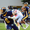 Brittany Chay - The News-Herald<br /> Euclid's Noah Mitchell throws a touchdown pass to Ramone Collins during the Panthers' 47-37 victory Sept. 15 at Euclid