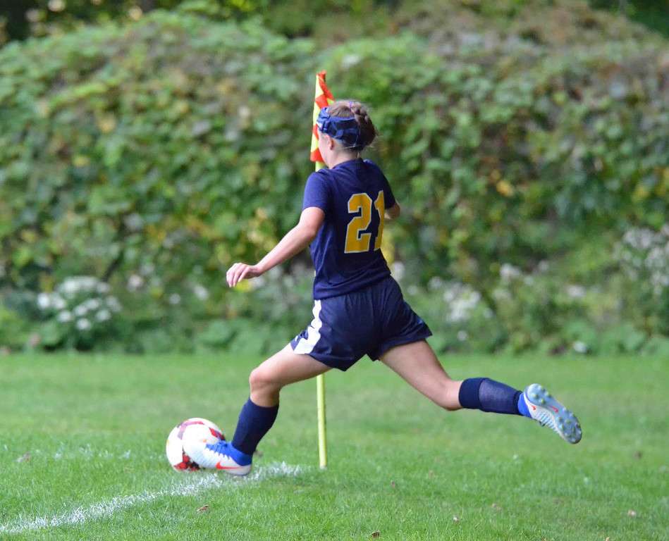 . Paul DiCicco - The News-Herald Wickliffe Senior, Brianna Rypinski attempting a corner kick in the first half of action at Kirtland on Sept 18.