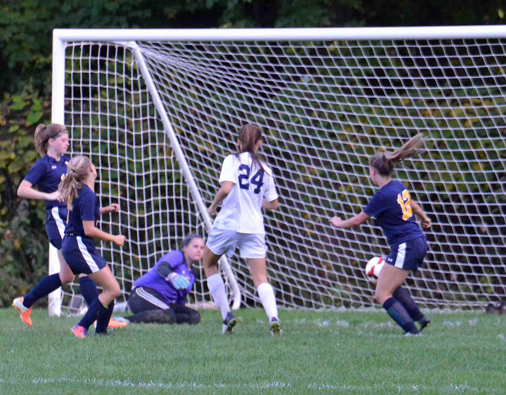 . Paul DiCicco - The News-Herald Kirtland\'s Jenna Sayle scores on a rebound shot late in the second half of play to secure the win oever Wickliffe, 6-0 on Sept 18