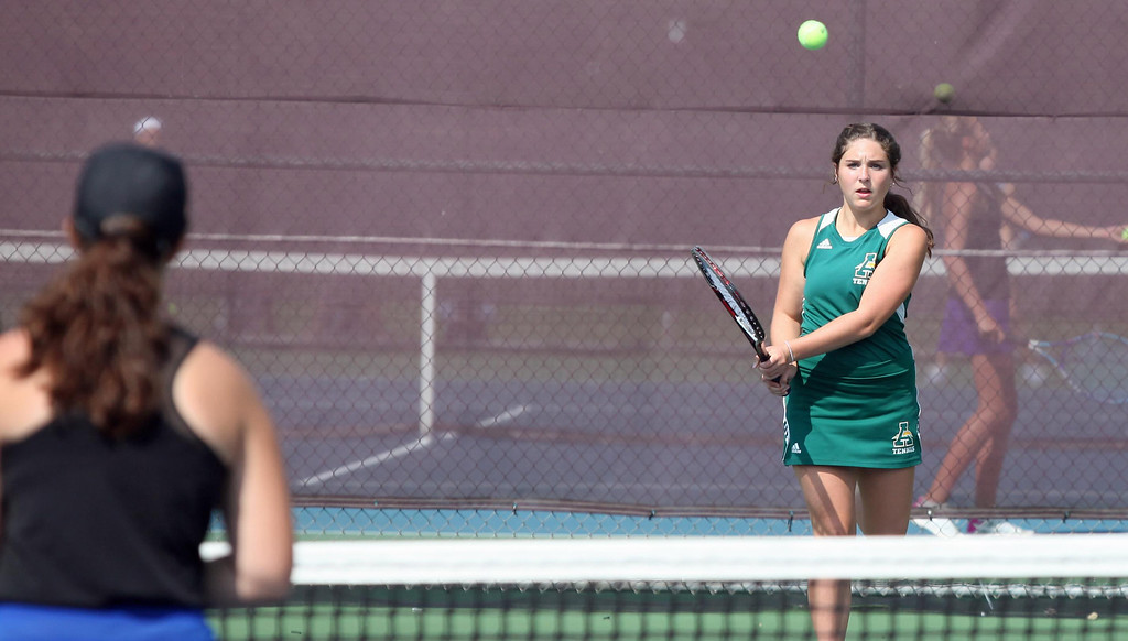 . Randy Meyers - The Morning Journal Emily Zichi of Amherst backhands a volley against Midview during a doubles match at the SWC Tournament on  Monday