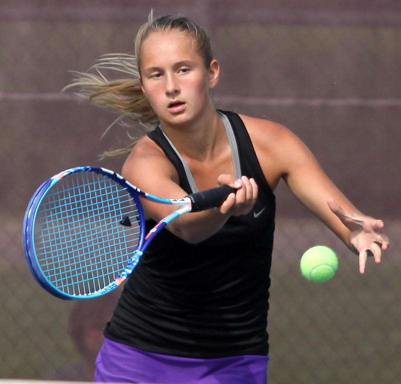 . Randy Meyers - The Morning Journal Avon\'s Alyssa McCullon retiurns a   serve against Westlake in a doubles match on Monday at the SWC   Tournament