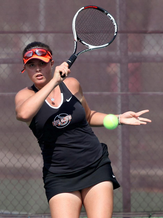 . Randy Meyers - The Morning Journal Otilia Oita of North Olmsted  returns a serves against Avon in a singles match at the SWC Tournament on  Monday