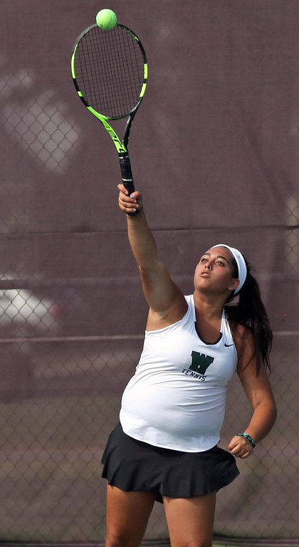 . Randy Meyers - The Morning Journal Westlake\'s Bella Zanotti serves  against Avon during a doubles match on Monday