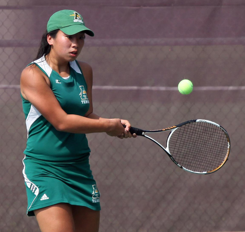 . Randy Meyers - The Morning Journal Brittnee Rourke of Amherst  backhands a volley against Lakewood at the SWC Tournament on Monday