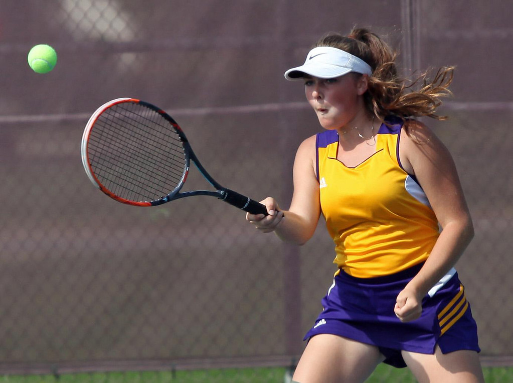 . Randy Meyers - The Morning Journal Lakewood\'s Gabby Elsel returns a  serves against Avon Lake in a doubles match at the SWC Tournament on  Monday