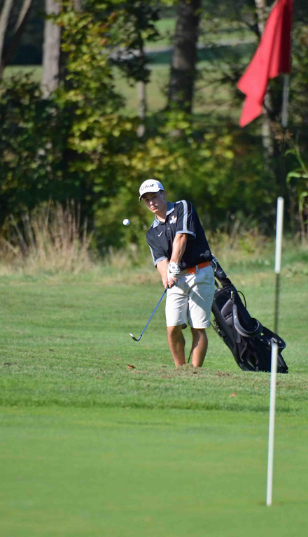 . Paul DiCicco - The News-Herald North Junior, Jack Sheehan. chips toward the hole on the second hole in a match against South at Manikiki Golf Course on Sept 21.
