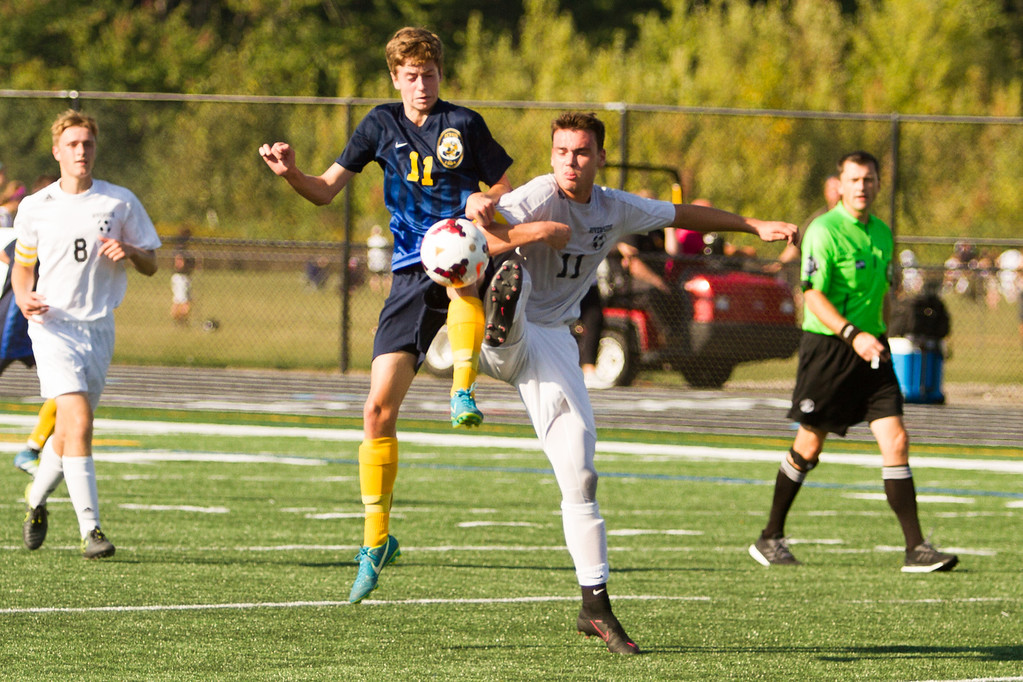 . Barry Booher - The News-Herald Kirtland\'s Jeremy Lunka and Riverside\'s Colin Shambaugh fight over a loose ball. Riverside won the match, 3-1, on Sept. 21.