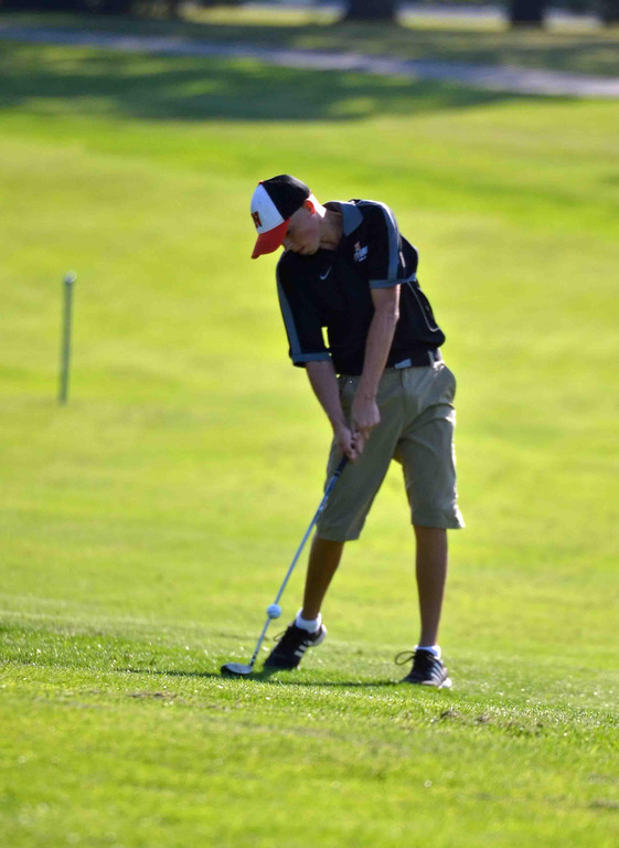 . Paul DiCicco - The News-Herald North Fewshman, Tyler Schwenk, hits his second shot on the third hole at Manikiki Golf Course on Sept 21.