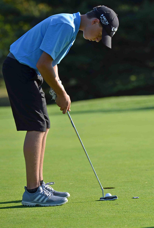. Paul DiCicco - The News-Herald South Junion Adam Paris, lines up to attempt a putt in a match against rival Eastlake North on Sept 21 at Manikiki Golf Course.